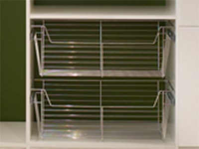 walk in closet with sliding wire basket